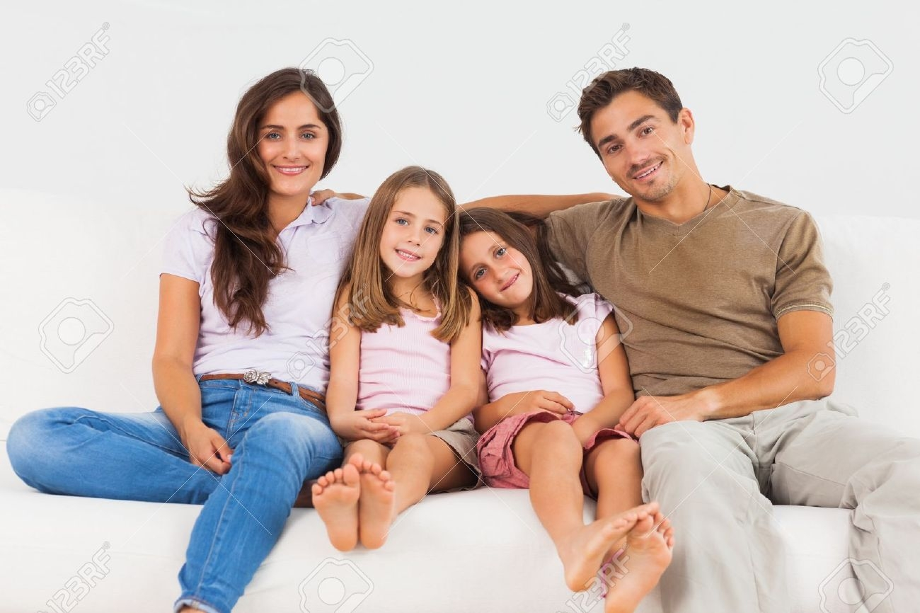 Cute Family Sitting On A Sofa In The Living Room Stock Photo For Family Sofa (#2 of 12)