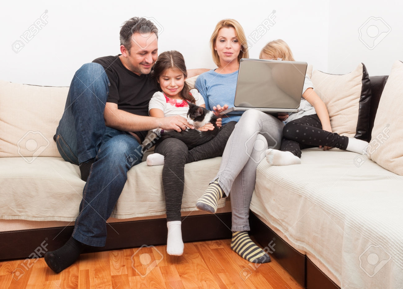 Happy Young Family Using Laptop On The Couch Or Sofa In The Living In Family Sofa (#8 of 12)