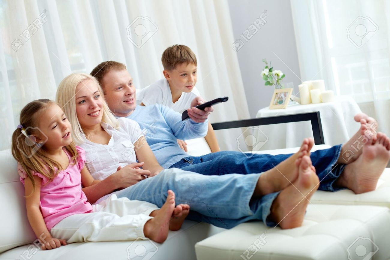 Portrait Of Happy Family With Two Children Sitting On Sofa And With Regard To Family Sofa (#10 of 12)