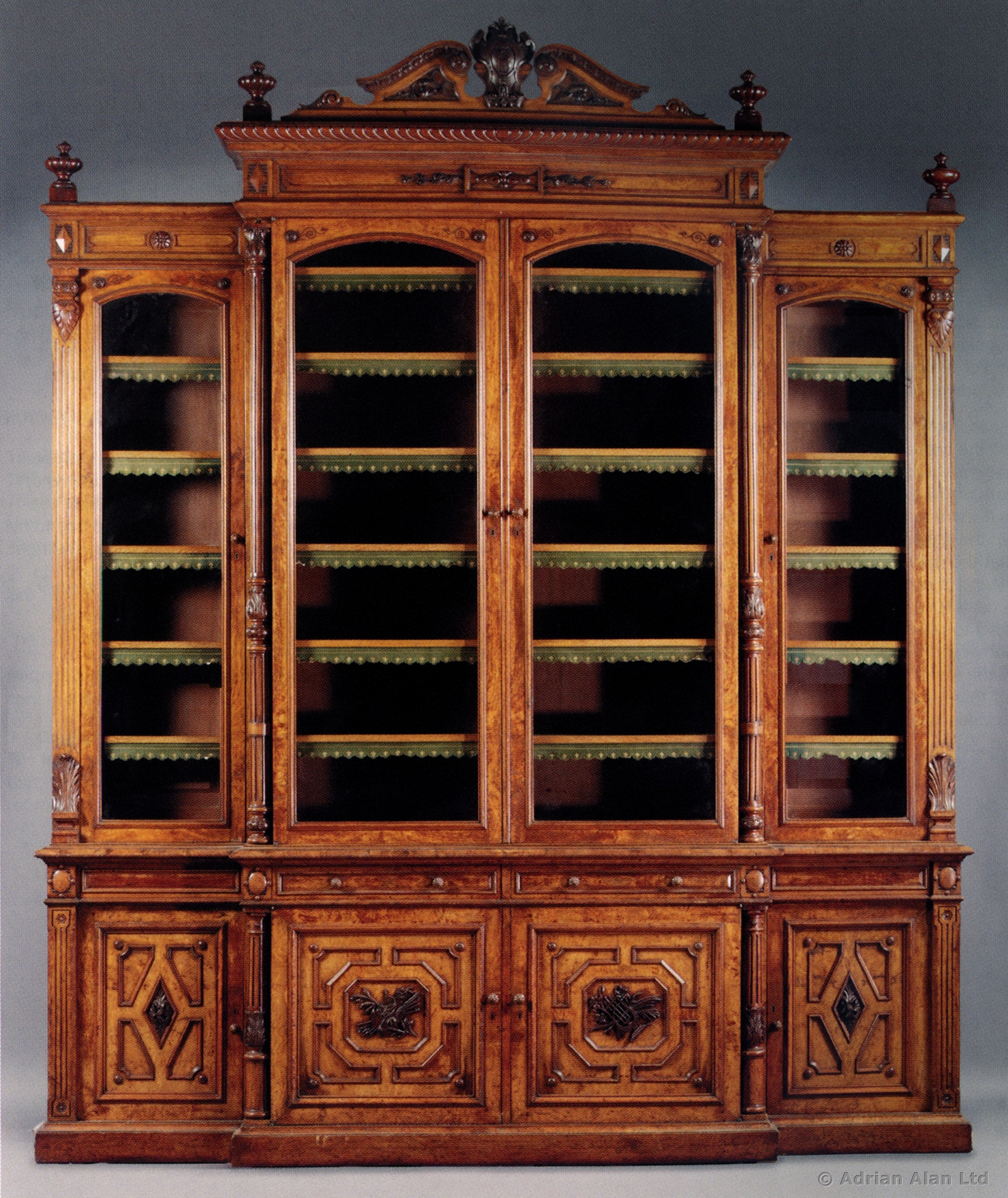 A Large Carved Oak And Pollard Oak Breakfront Library Bookcase With Regard To Oak Library Bookcase (#3 of 15)