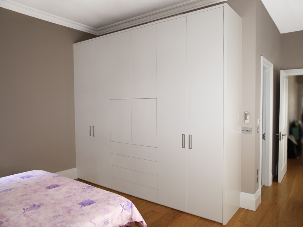 Bedroom A Modern Bedroom Double Bed Wooden Table Below Window Inside Fitted Wooden Wardrobes (View 4 of 15)
