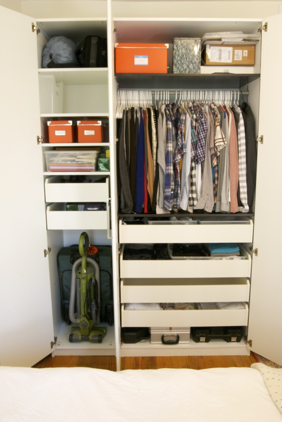 Big And Small Drawers On The High White Wooden Wardrobe Combined Inside Wardrobes With Drawers And Shelves (View 3 of 15)