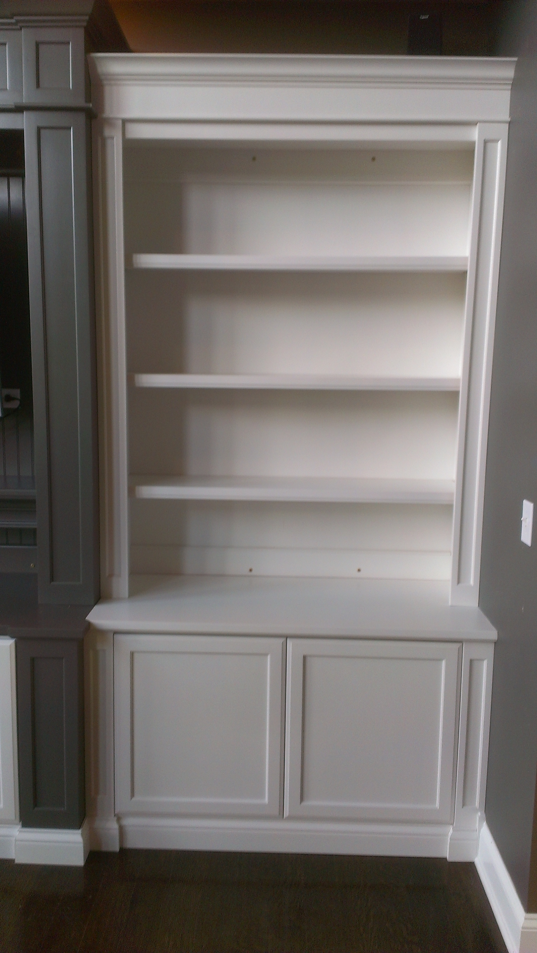15 photo of bookshelf with cabinet base