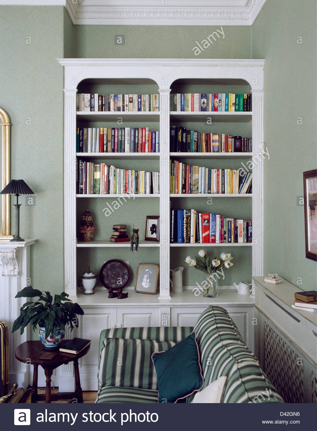 Fitted Bookshelves In Alcove Beside Striped Green Sofa In Gray With Regard To Fitted Bookshelves (#8 of 15)