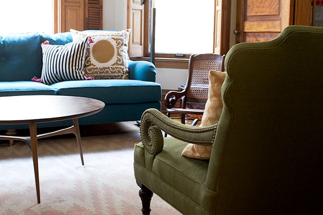 Scroll Arm Chairs In Front Of The Fireplace Making It Lovely With Regard To Green Sofa Chairs (View 6 of 15)