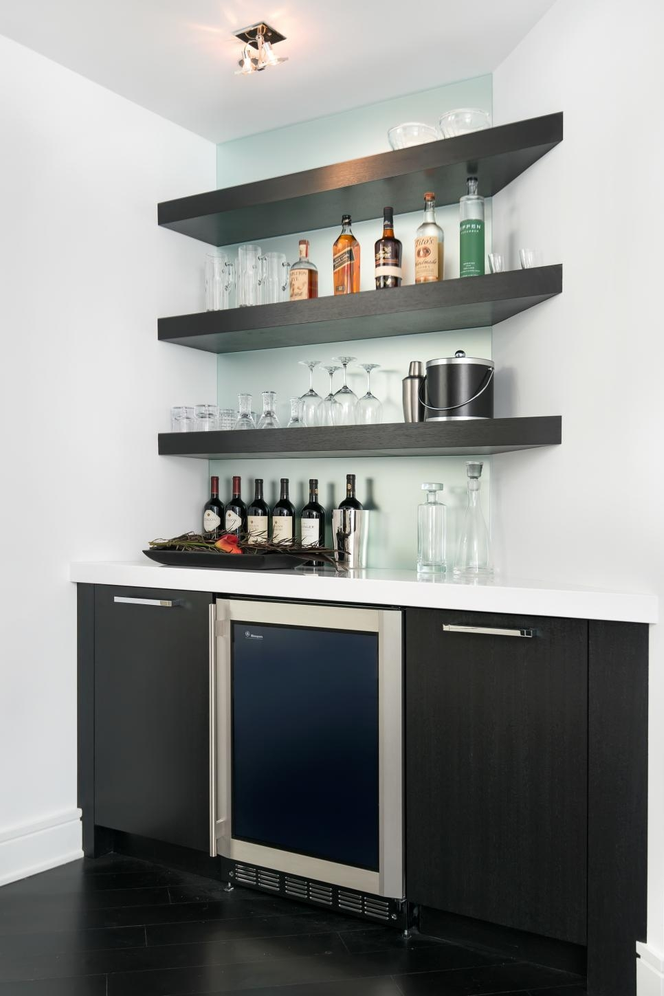 This Modern Wet Bar Features Floating Corner Shelves And A Frosted Throughout Floating Glass Shelves For Bar (View 15 of 15)