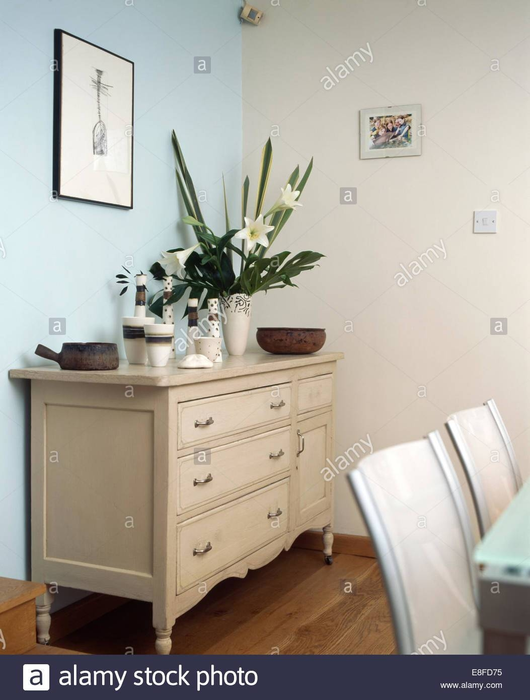 Ceramic Vases And Vase Of White Lilies On Cream Sideboard In Inside Cream Sideboard (#4 of 20)
