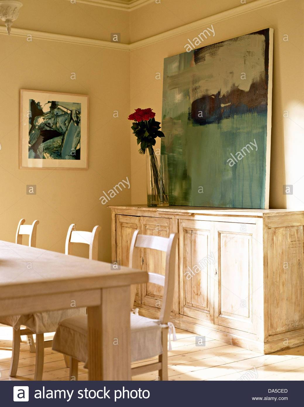 Large Painting On Distressed Wood Sideboard In Neutral Dining Room Throughout Distressed Wood Sideboard (View 15 of 20)