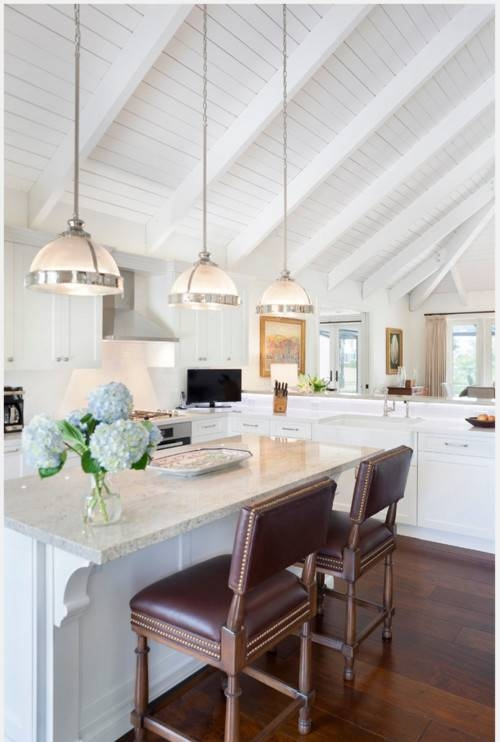 Three White Half Ball Pendant Lights Hang From A Tall Vaulted In Pendant Lights For Vaulted Ceilings (#12 of 15)