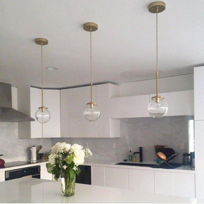 Modern Kitchen Using Clear Glass Pendants Hung Over Island – Glass Pertaining To Newest Modern Glass Pendants (View 3 of 15)