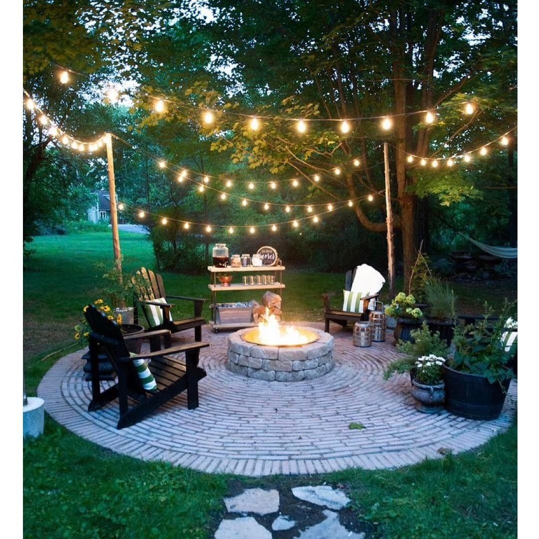 20 Dreamy Ways To Use Outdoor String Lights In Your Backyard Intended For Hanging Outdoor Lights On Brick (#2 of 15)