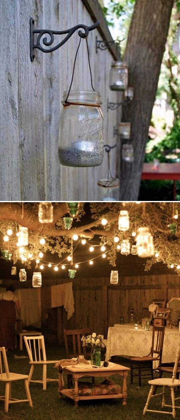 Adorn Your Backyard Tree With String Lights And Hanging Mason Jar Within Outdoor Hanging Mason Jar Lights (#2 of 15)