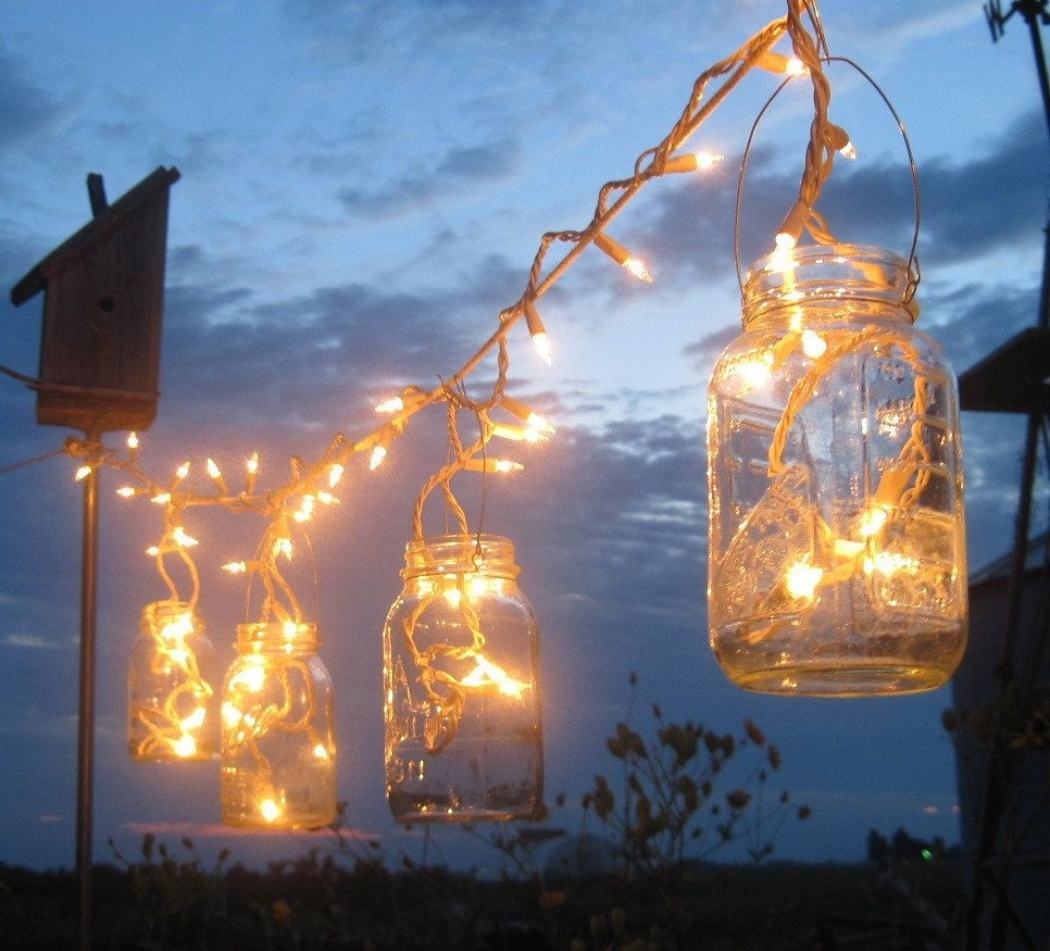 Backyard Lighting – Icicle Lights In Mason Jars | Home | Pinterest Regarding Outdoor Hanging Lanterns For Wedding (View 12 of 15)