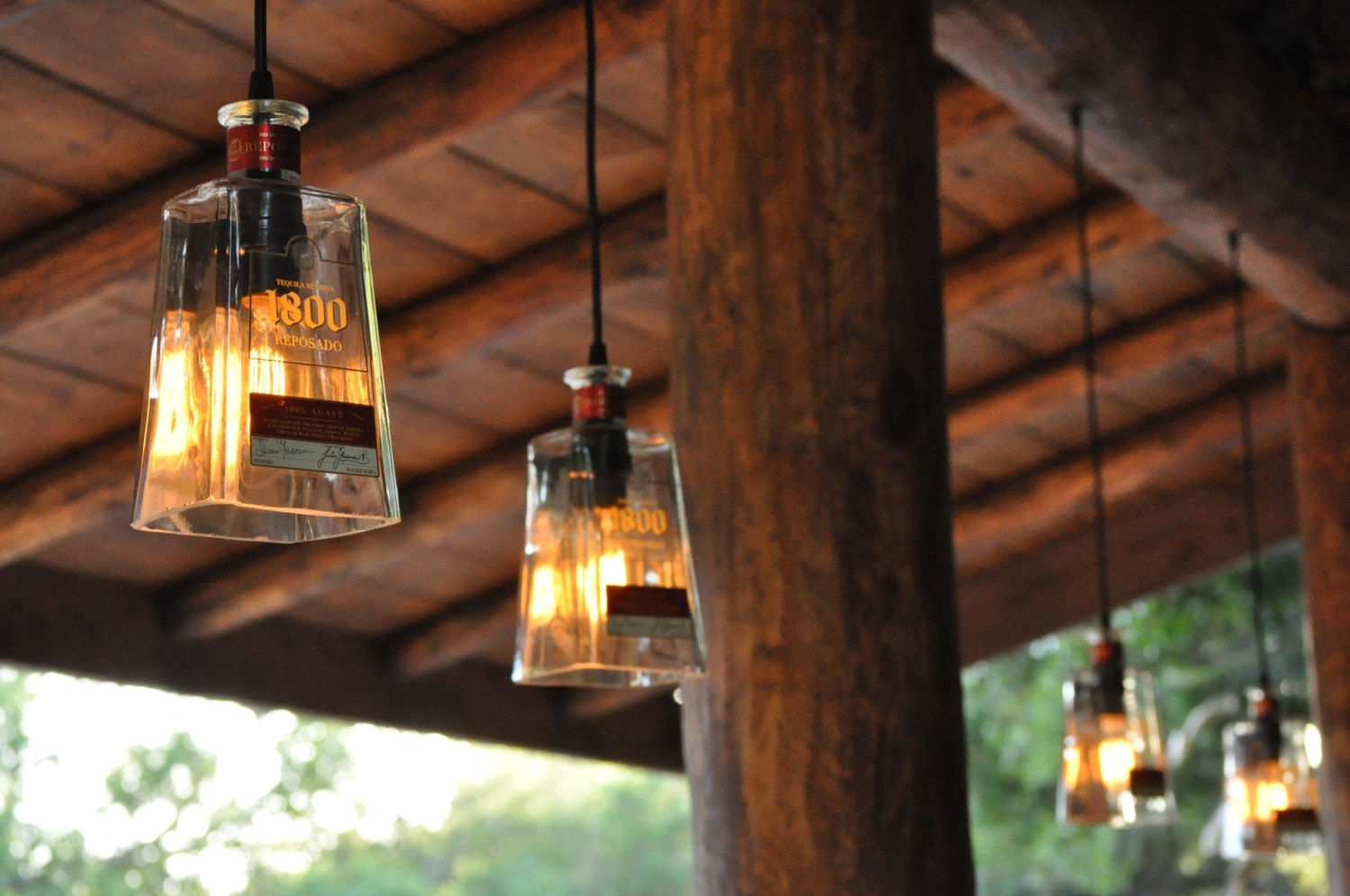 Fabulous Tequila Clear Glass Bottle Pendant Lamp In A Patio – Artenzo Pertaining To Outdoor Ceiling Lights For Patio (#4 of 15)