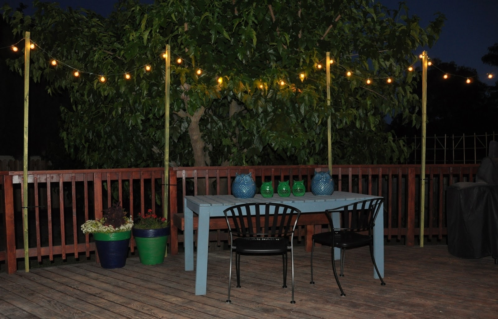 Hit Wood Dining Table Chairs Dark Loandco Newest How To Use String Throughout Outdoor Hanging Lights For Trees (View 12 of 15)