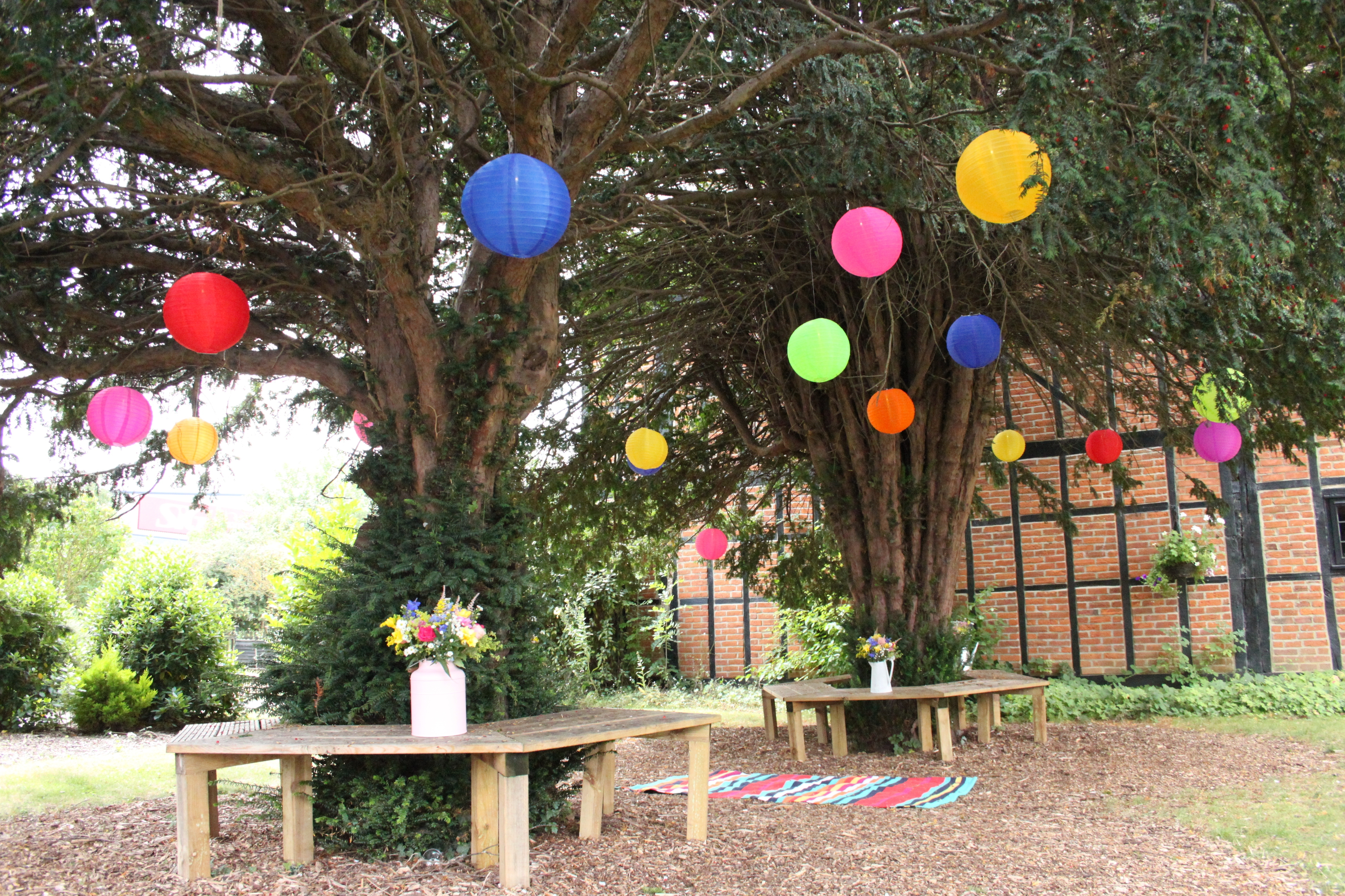 Mad Hatters Outdoor Coloured Nylon Lanterns Hanging Randomly In The Throughout Outdoor Hanging Lanterns For Trees (View 14 of 15)
