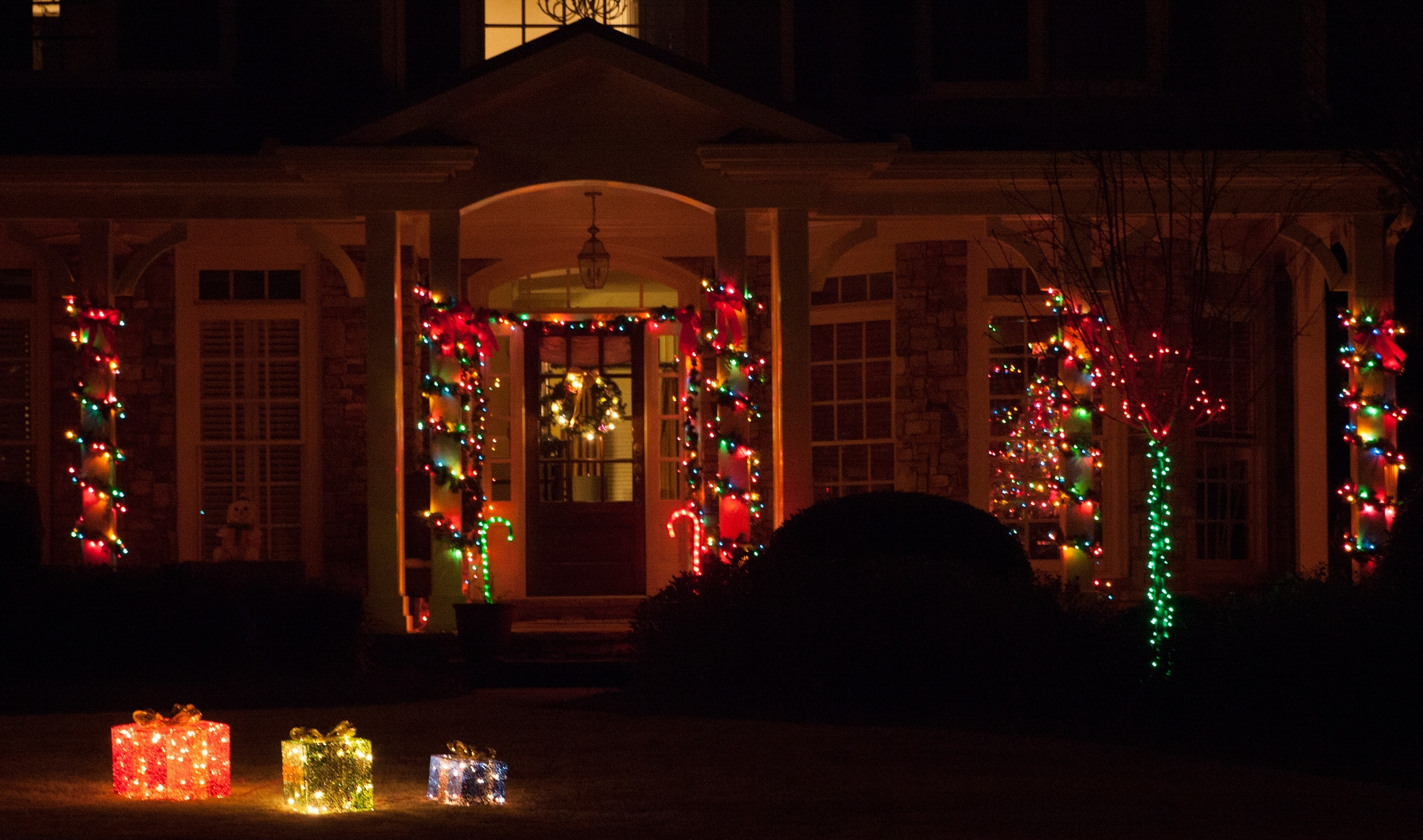 Porch Decorations With Hanging Outdoor Christmas Lights Around Windows (#15 of 15)