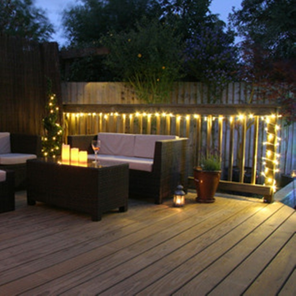 Stylish Wooden Deck With Wicker Furniture For Decorative Garden Throughout Outdoor Hanging Wall Lights (#17 of 18)