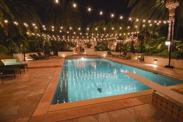 5 Reasons String Lights Over Your Swimming Pool Are A Bad Idea Inside Outdoor Pool Lanterns (View 10 of 15)