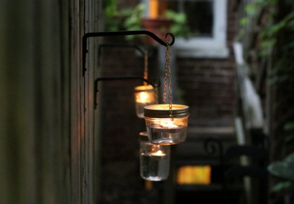 Over On Ehow: Diy Hanging Mason Jar Lights | 17 Apart Regarding Outdoor Lanterns And Votives (View 9 of 15)
