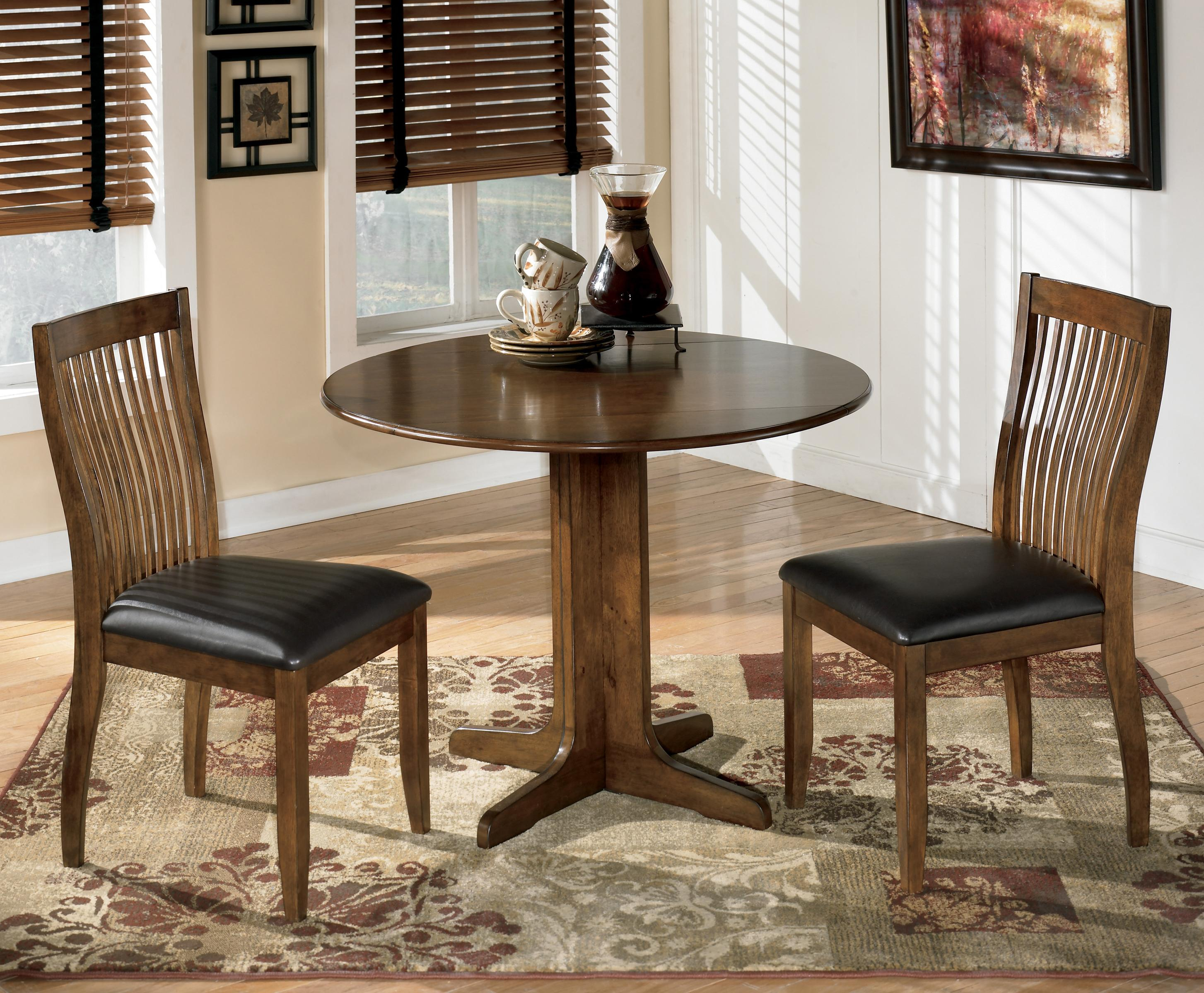 Signature Designashley Stuman 3 Piece Round Drop Leaf Table Set Within Most Recent Moorehead 3 Piece Counter Height Dining Sets (#12 of 20)