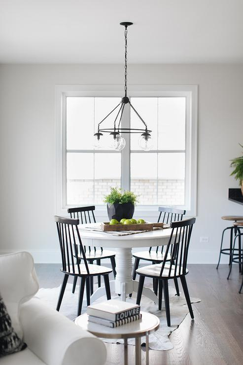 Popular Round White Pedestal Dining Table With Black Windsor Chairs Throughout Rae Round Pedestal Dining Tables (#16 of 30)