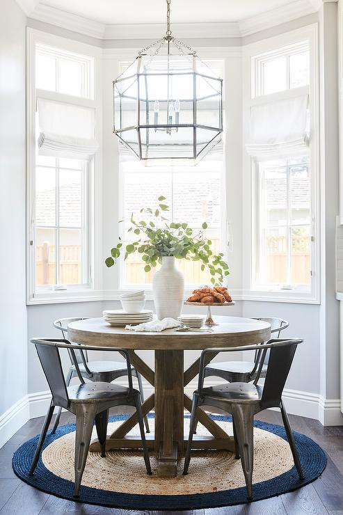 Popular Round Wood Dining Table On Round Jute Rug – Transitional With Regard To Morris Round Dining Tables (#18 of 20)