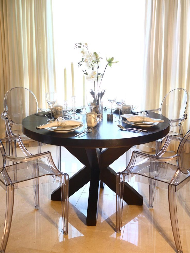 Well Known Elegance Large Round Dining Tables Throughout This Elegant Dining Room Features A Large Round Wood Dining (View 10 of 20)