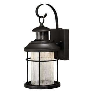 Shop Tudor Bronze Motion Sensor Dusk To Dawn Outdoor Wall Throughout Brook Black Seeded Glass Outdoor Wall Lanterns With Dusk To Dawn (View 2 of 20)